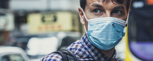 Man wearing mask for protection against coronavirus