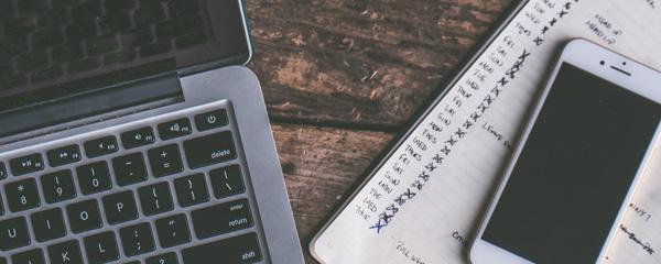 laptop, phone and agenda